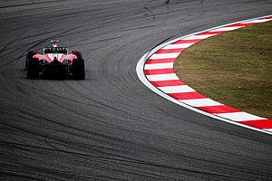 Fernando Alonso driving for Scuderia Ferrari a...