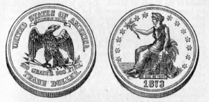 A United States silver trade dollar of 1873. B...