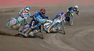 English: Speedwayriders riding in start number...