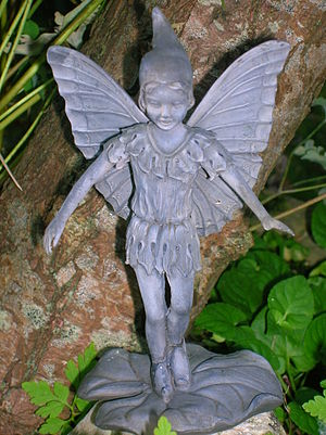 A resin statue of a Fairy in natural surroundi...