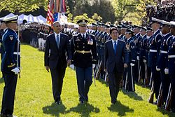 Abe and then US President Barack Obama review troops during the former's visit to Washington DC in April 2015