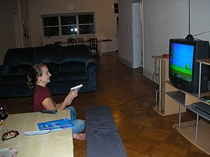 woman playing Duck Hunt video game, lightgun
