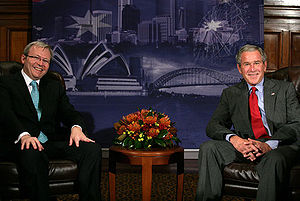 President George W. Bush sits with Kevin Rudd,...