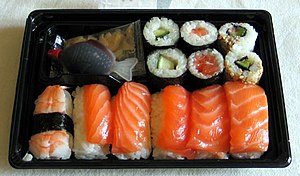 Sushi bento, with the sashimi on the top.