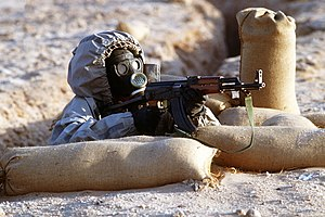 English: A Syrian soldier aims an TYPE 56-1S (...