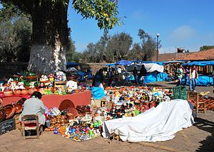 English: Selling crafts just outside the entra...