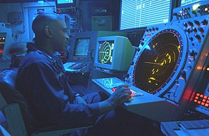 A U.S. Navy air traffic controller watches his...