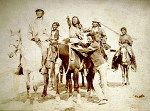 Crow Indians mounted on horseback