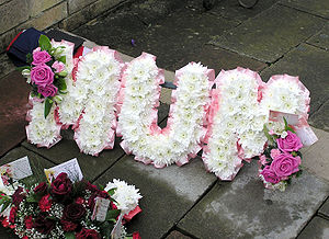 A floral name tribute (spelling out the word &...