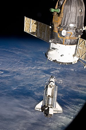 The space shuttle Discovery and the Internatio...