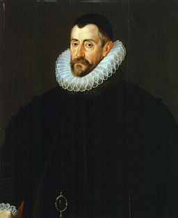 Oil painting of dour Elizabethan man in dark clothes and stiffly starched ruff