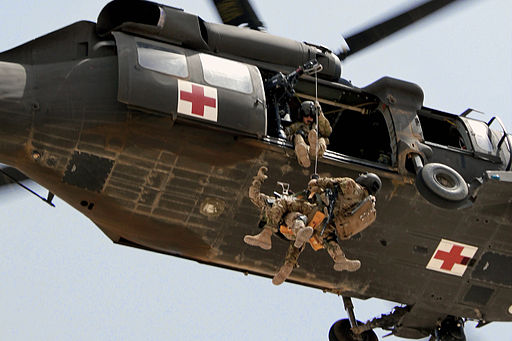 Defense.gov News Photo 110716-A-6909A-163 - U.S. Army Staff Sgt. Travis Brown and a German soldier are hoisted up into a UH-60L Black Hawk helicopter during rescue hoist training at Camp