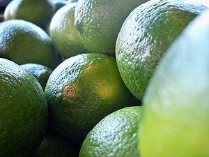 English: Limes at a market.