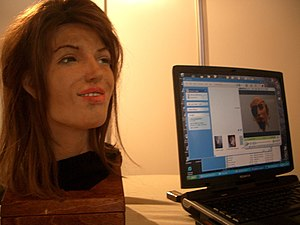 A robot by Human Emulation Robotics. Her facia...