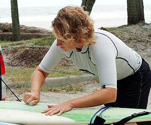 Waxing a surfboard