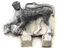 Stone relief showing a manticore while killing...