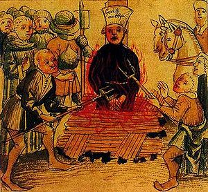 A victim of the inquisition being burned and t...