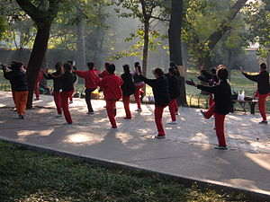 People performing Tai Chi Chuan at the Temple ...