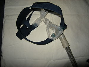 A typical CPAP mask. The opening goes over the...