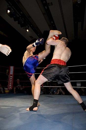 High kick and block