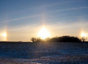 English: Sun dogs during sunset outside of New...