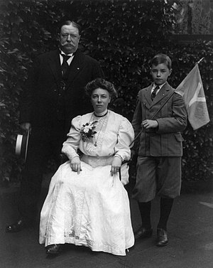 Mr. Taft and son standing; Mrs. Taft seated, o...