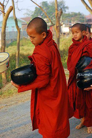 Monks receive alms, Nyaungshwe, Myanmar