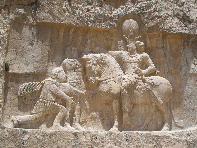 Bas relief nagsh-e-rostam al. The bas-relief also depicts Phillip the Arab. He is depicted standing because he was not defeated while Valerian's capture entitled him to be depicted in a more submissive manner.