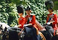 Elizabeth in red uniform on a black horse