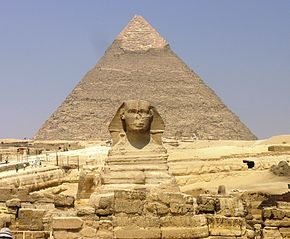 Giza Plateau - Great Sphinx with Pyramid of Khafre in background.JPG