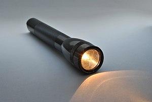 A lit flashlight