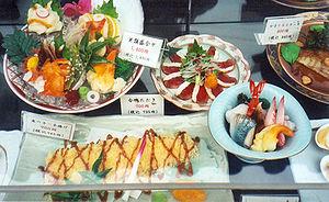 Molded plastic food replicas on display outsid...