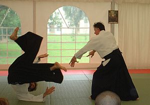 A classical aikido throw being practiced. Tori...