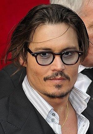 Johnny Depp during the Paris premiere of Publi...