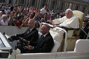 The ailing Pope John Paul II riding in the Pop...