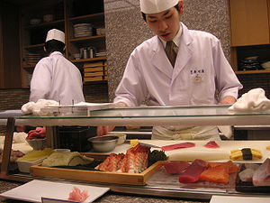Sushi chef working in a restaurant in Kyoto St...