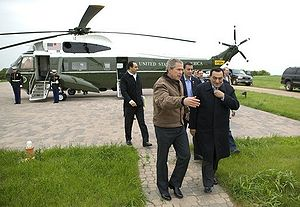 President George W. Bush escorts President Hos...