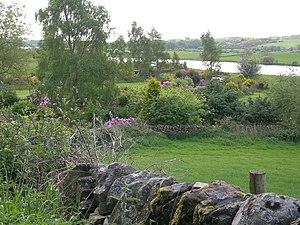 English: Farmland, cottage gardens & Loch Ken