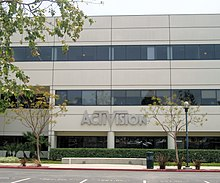 "A grey nondescript building with the text ""Activision"" on the first floor."