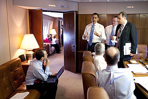 President Barack Obama meets with staff aboard...