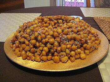 English: Struffoli made in the traditional way...