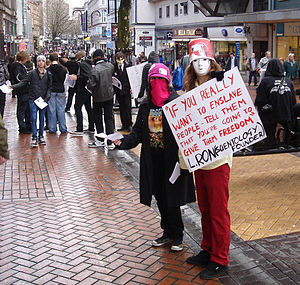 Interestingly dressed Anonymous protestors gre...