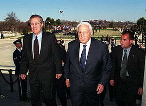 Secretary of Defense Donald H. Rumsfeld (left)...
