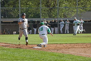 English: A Batter runs to first base attemptin...