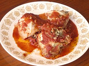 Holishkes or Cabbage rolls covered with tomato...