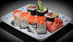 Grandma's birthday - sushi on rectangular plate.