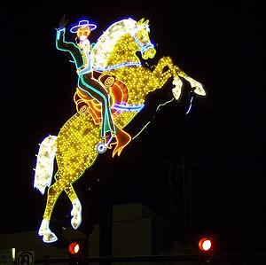 Letrero de un jinete y caballo