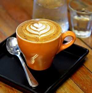 English: Latte art on a cappuccino at Doppio R...
