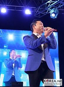 220px PSY GangnamStyle Suwon15logo %288031994935%29 2010s Fashion
