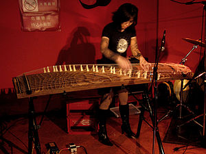 Artist Yagi Michiyo plays a bass koto